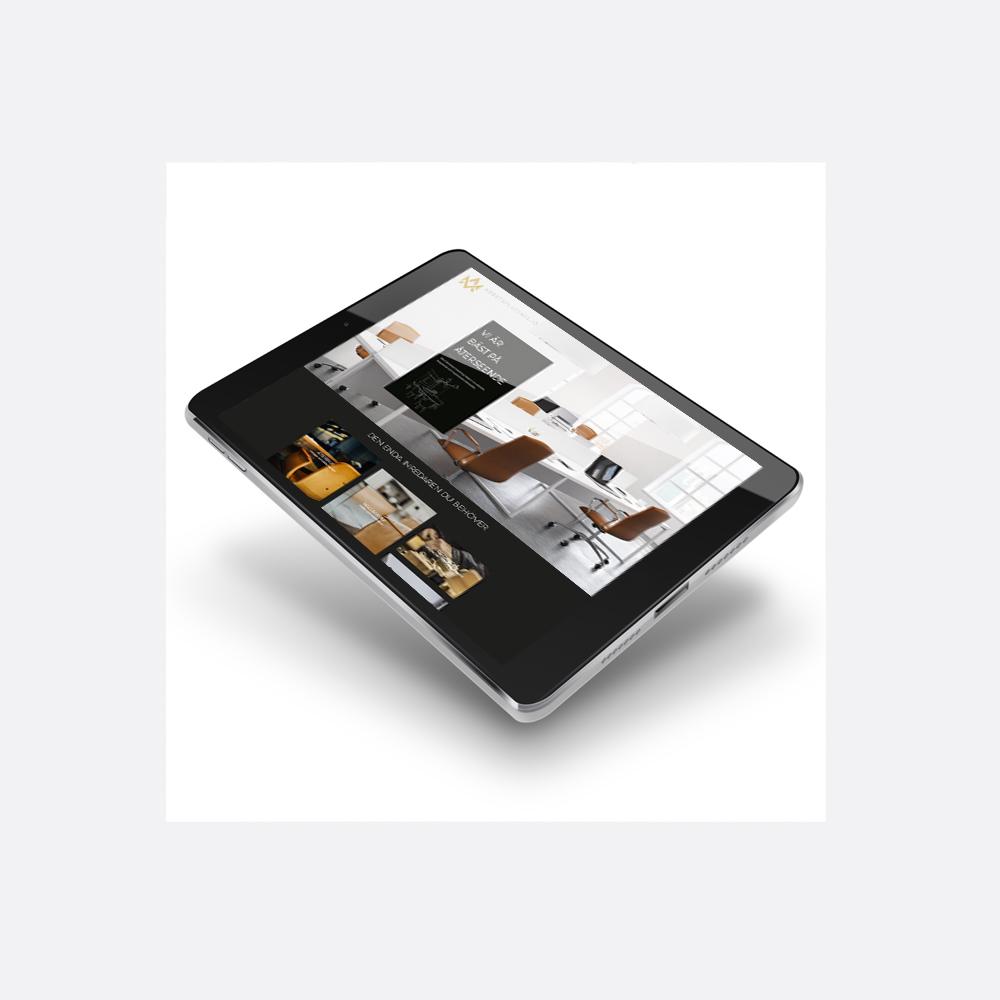 iPad med Arbetsplatsmiljö responsiv webbsida